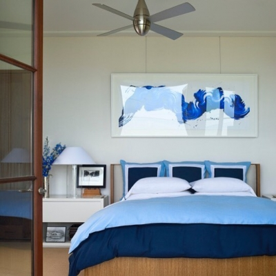 We're getting our #color fix on this rainy #Monday afternoon! A natural fiber carpet graces a summery bedroom in Sag Harbor Bay, NY. Design by Foley and Cox Interiors, Photography by Bruce Buck. #BeautifulBlues #Summertime #NaturalCarpet #CustomCarpet #ColorPop #BedroomDesign #Inspiration #Aronsons #AronsonsFloorCovering