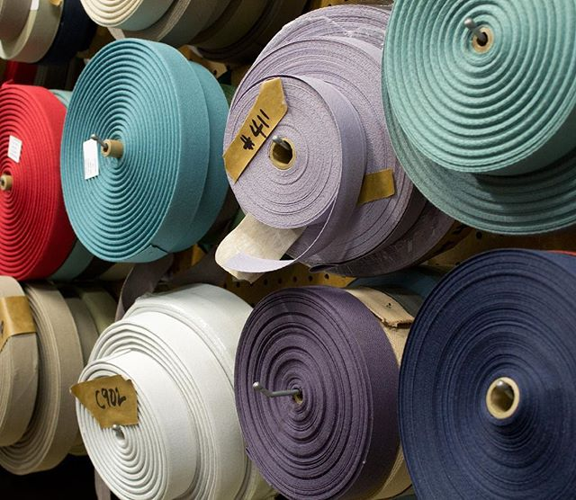 Take a glimpse into the colorful-filled, bountiful binding area in our fabrication area where our carpets are made by hand onsite in our Chelsea showroom. ⠀